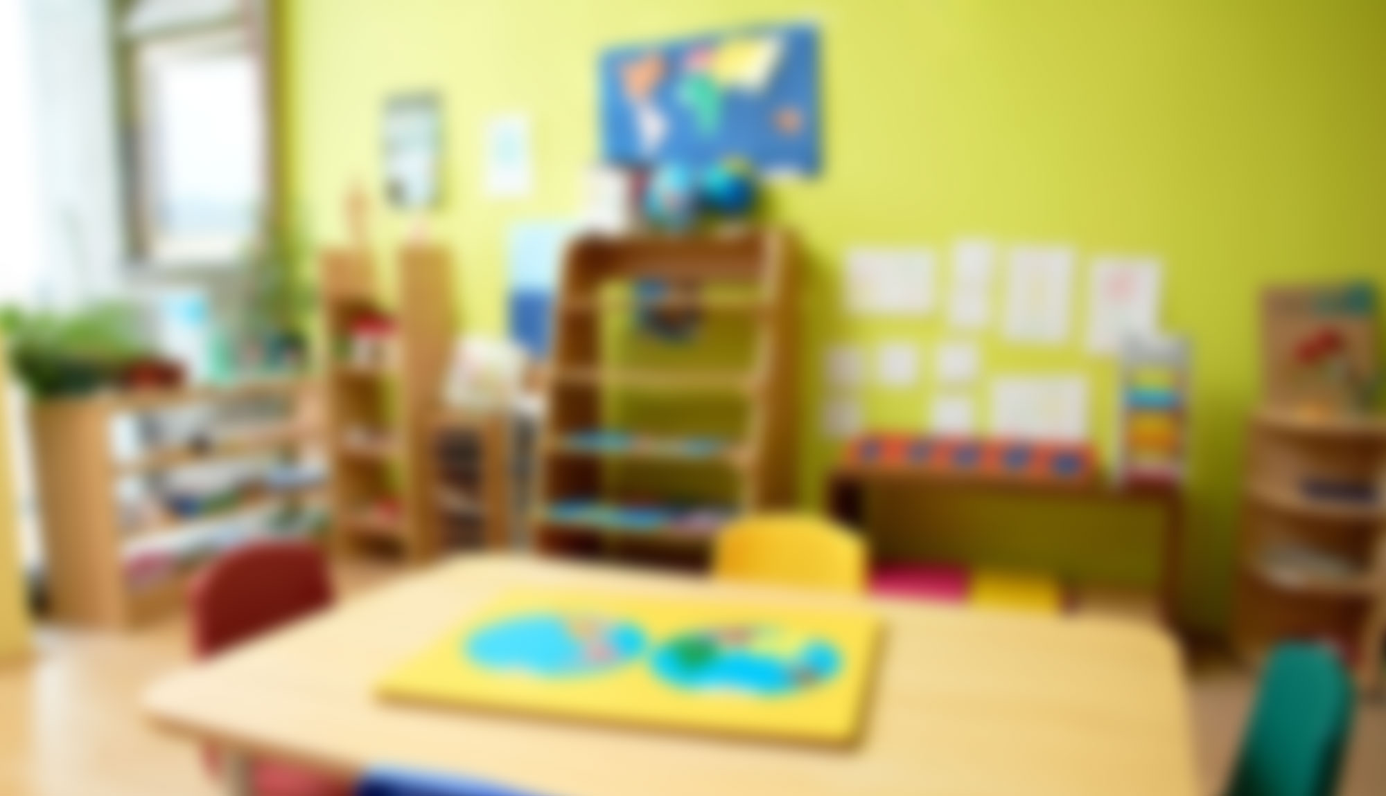 A photograph with blur effect of a colorful speech therapy room for children